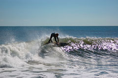 surfing on long beach island at the new jersey shore